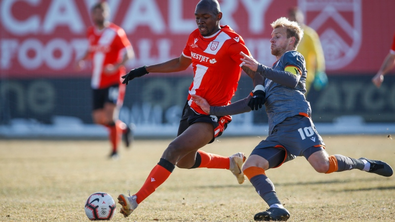 Hamilton Forge's Kyle Bekker, right, vies for the ball with Calgary Cavalry's Jordan Brown during Canadian Premier League soccer final action in Calgary, Alta., Saturday, Nov. 2, 2019. (THE CANADIAN PRESS/Jeff McIntosh)