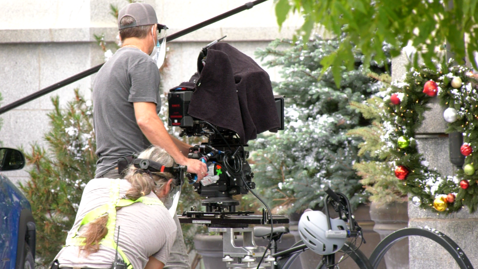 A crew member works on the Hallmark film