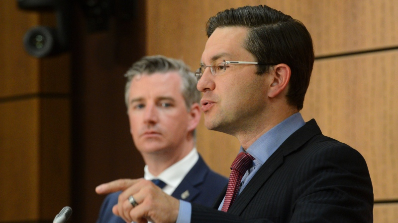 Conservative MP's Pierre Poilievre and Michael Barrett hold a press conference on Parliament Hill in Ottawa on Wednesday, July 29, 2020. THE CANADIAN PRESS/Sean Kilpatrick