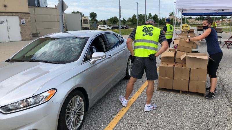 Windsor residents lineup up for free hand sanitizer on Thursday in Windsor, Ont., on July 30, 2020. (Angelo Aversa / CTV Windsor)
