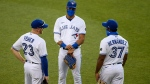 Toronto Blue Jays outfielders Derek Fisher (23), Lourdes Gurriel Jr., center, and Teoscar Hernandez (37) talk during a pitching change during the seventh inning of a baseball game against the Washington Nationals, Wednesday, July 29, 2020, in Washington. The Nationals won 4-0 in extra innings. (AP Photo/Nick Wass)