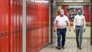 Ontario Premier Doug Ford, left, and Education Minister Stephen Lecce walk the hallway before making an announcement regarding the governments plan for a safe reopening of schools in the fall due to the COVID-19 pandemic at Father Leo J Austin Catholic Secondary School in Whitby, Ont., on Thursday, July 30, 2020. THE CANADIAN PRESS/Nathan Denette