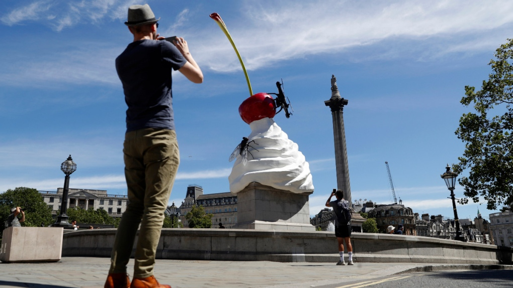 Ominous whipped cream art comes to London's Trafalgar Square