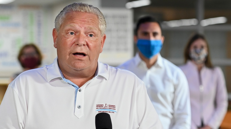 Ontario Premier Doug Ford makes an announcement regarding the governments plan for a safe reopening of schools in the fall due to the COVID-19 pandemic at Father Leo J Austin Catholic Secondary School in Whitby, Ont., on Thursday, July 30, 2020. THE CANADIAN PRESS/Nathan Denette