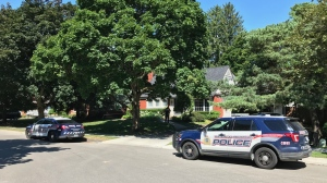 Two police cruisers seen on Forsyth Drive in Waterloo after emergency services responded to a medical call there. (Dan Lauckner / CTV Kitchener)