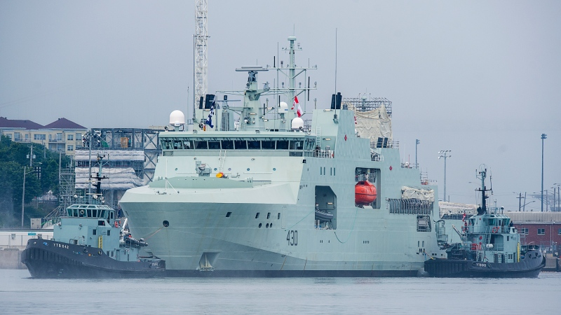 HMCS Harry DeWolf heads from the Irving-owned Halifax Shipyard on its way to being delivered to the Royal Canadian Navy dockyard in Halifax on Wednesday, July 31, 2020. The vessel is the first of the new offshore Arctic patrol ships and will conduct surveillance operations, assist in anti-smuggling and anti-piracy operations as well as humanitarian assistance and disaster relief. (THE CANADIAN PRESS/Andrew Vaughan)