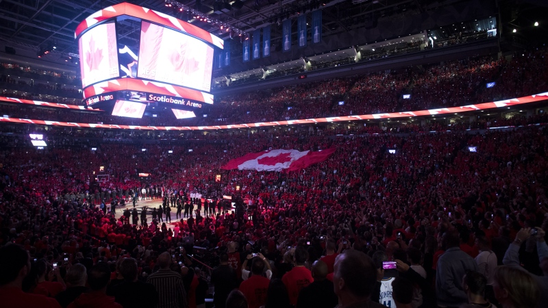 "The Toronto Raptors will treat both national anthems as ""one long song"" ahead of their opening game of the NBA restart on Saturday, according to coach Nick Nurse. Fans sing during the Canadian national anthem ahead of first half of Game 5 NBA Finals basketball action between the Toronto Raptors and the Golden State Warriors in Toronto on Monday, June 10, 2019. THE CANADIAN PRESS/Chris Young"