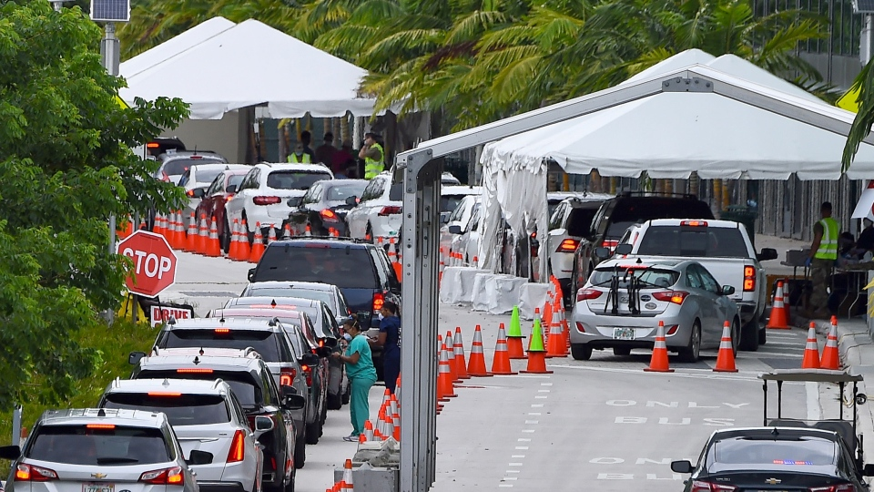 In this file photo cars line up for Covid-19 test at a 'walk-in' and 'drive-through' coronavirus testing site in Miami Beach, FL, on July 22, 2020. (Chandan Kahanna/AFP/AGetty Images)