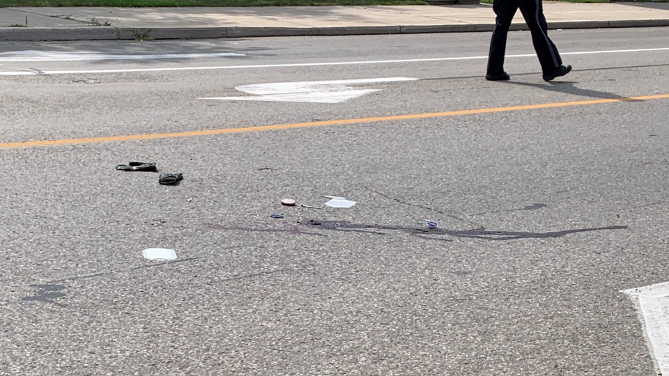 Debris is scattered at the scene of a fatal pedestrian collision in Ingersoll, Ont. on Friday, July 31, 2020. (Taylor Choma / CTV News)