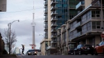 The CN Tower can be seen behind condos in Toronto's Liberty Village community in Toronto, Ontario on Tuesday, April 25, 2017. As rent cheques come due, some are warning that Ontarians should prepare for a wave of evictions now that protections put in place earlier in the COVID-19 pandemic have been lifted. THE CANADIAN PRESS/Cole Burston