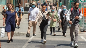 Pedestrians walk along Ste. Catherine Street Thursday, June 11, 2020 in Montreal. A coalition of Quebec doctors is calling on the government to make the wearing of face masks mandatory in all indoor public places and outdoors in situations where social distancing is not possible. THE CANADIAN PRESS/Ryan Remiorz