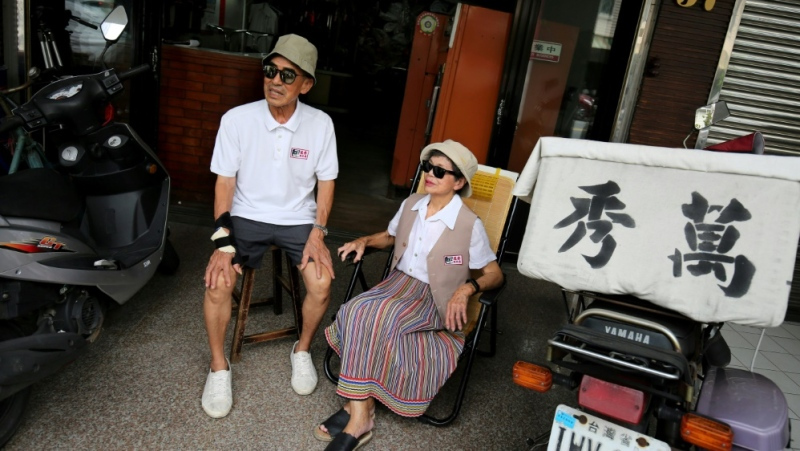 Chang Wan-ji and his wife Hsu Sho-er have racked up nearly 600,000 followers on Instagram over the last month after posting their attitude-filled fashion portraits. (AFP)