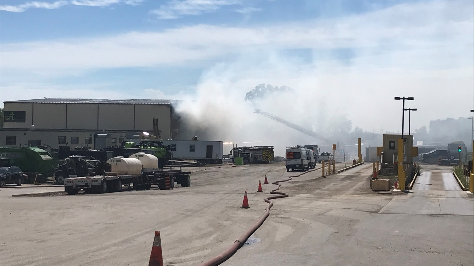 Firefighters battled an early-morning fire at a Kitchener industrial building on Saturday, August 1, 2020. (Edwin Huras / CTV Kitchener)