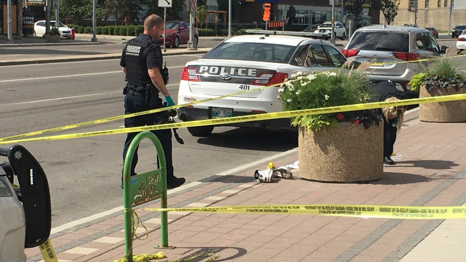 Police tape blocked off a section of the sidewalk on Portage Avenue Saturday. (Zach Kitchen/CTV News)