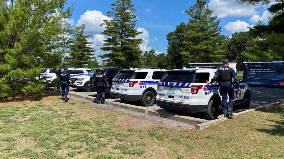Ottawa police are searching the Ottawa River near Bate Island for the second of two men reported missing Friday night. The body of one man was recovered overnight. Aug. 1, 2020. (Jeremie Charron / CTV News Ottawa)