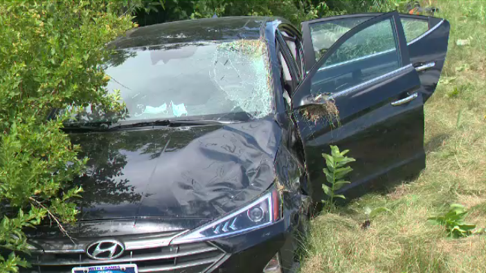 A two-vehicle crash in Kitchener sent one car into a ditch on Saturday, August 1, 2020. (Edwin Huras / CTV Kitchener)