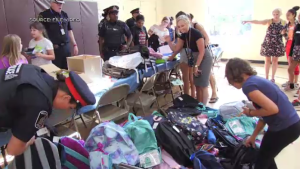 Waterloo Regional Police hand out backpacks during their second annual backpack challenge on Aug. 20, 2019. (Spencer Turcotte / CTV Kitchener)