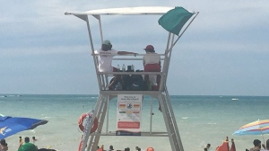 Lifeguards watch the beach in Grand Bend Ont. on Aug. 1, 2020. (Brent Lale/CTV London)