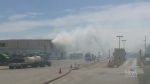 Crews battle fire at Kitchener industrial building