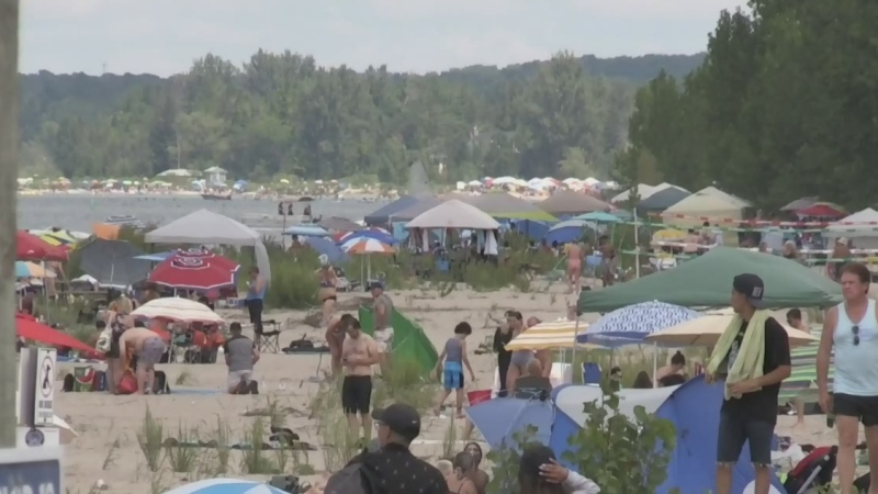 Beaches, parks, and resorts were jammed Saturday before the arrival of rain