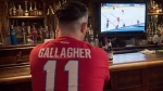 A man watches the NHL Stanley Cup playoffs at a bar in Montreal, Saturday, Aug. 1, 2020. THE CANADIAN PRESS/Graham Hughes