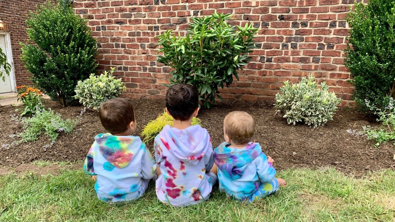 Maya Joyandeh of Teaneck, N.J., enlisted her six-year-old daughter (centre) to tie-dye sweatshirts for her younger brothers. (Courtesy Maya Joyande / CNN)