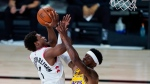 Toronto Raptors' Kyle Lowry shoots over Los Angeles Lakers' Kentavious Caldwell-Pope during the second half of an NBA basketball game Saturday, Aug. 1, 2020, in Lake Buena Vista, Fla. (AP Photo/Ashley Landis, Pool)