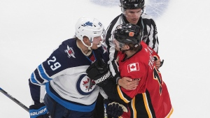 Winnipeg Jets' Patrik Laine (29) and Calgary Flames' Matthew Tkachuk (19) get in each other's face during second period NHL qualifying round game action in Edmonton, on Saturday August 1, 2020. THE CANADIAN PRESS/Jason Franson