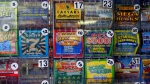 In this Thursday, July 17, 2014 photo, scratch-off lottery tickets for sale are on display at Eagles Express in Knightdale, N.C. (AP Photo/Gerry Broome)
