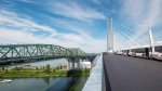 The old Champlain bridge, left, is seen next to the new Samuel de Champlain bridge in Montreal, Friday, June 28, 2019. The old one will be dismantled in the coming months. THE CANADIAN PRESS/Ryan Remiorz