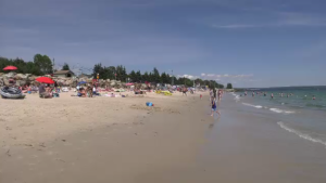 During a time where social-distancing is a requirement, officials are urging people who plan on visiting a beach to use good judgement when deciding if there are too many people around.