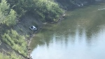 A white sedan was found stuck in the mud in Sandy Beach Park near the Elbow River Sunday.