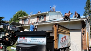 Firon Roofing helped to organize several Ottawa roofers who helped restore a local woman's roof for free after it was left half-finished by a previous contractor. (Dave Charbonneau / CTV News Ottawa)