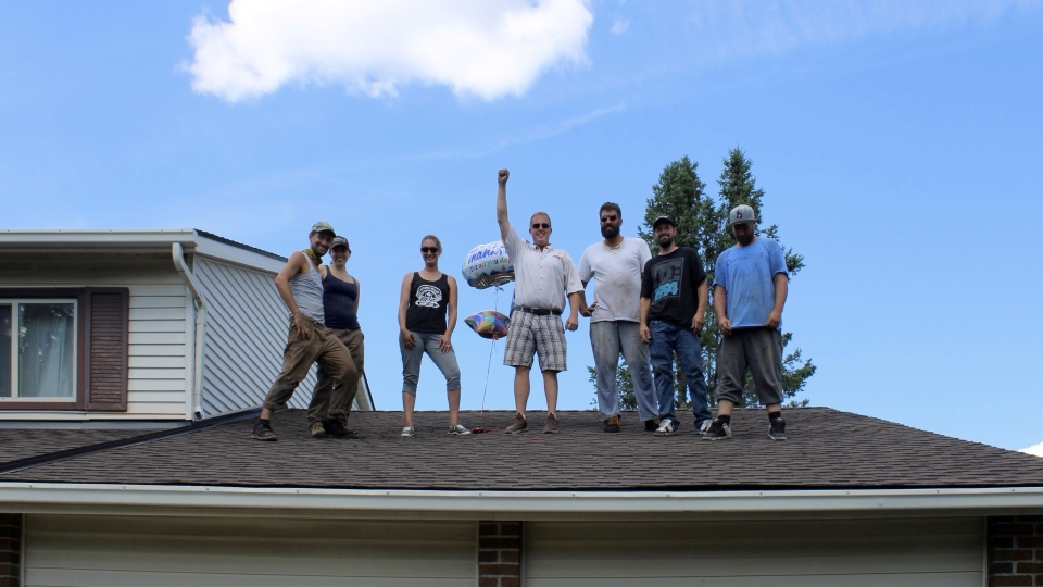 Roofers from across Ottawa gathered to restore a woman's roof for free after the previous contractor left the job half-finished. (Dave Charbonneau / CTV Ottawa)