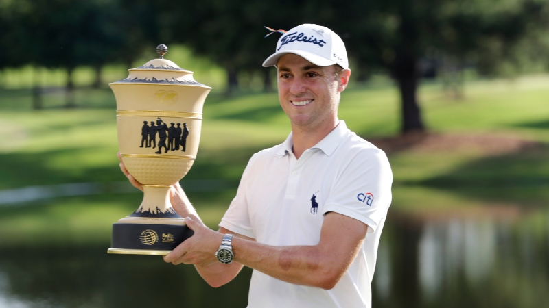 Justin Thomas holds the trophy after winning the World Golf Championship-FedEx St. Jude Invitational Sunday, Aug. 2, 2020, in Memphis, Tenn. (AP Photo/Mark Humphrey)