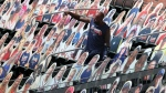 Atlanta Braves outfielder Marcell Ozuna takes a selfie with cutouts of his wife Genesis Guzman and their 3 children in the stands filled with cutout fans behind the Braves dugout before playing the New York Mets in a MLB baseball game on Sunday, Aug. 2, 2020 in Atlanta. (Curtis Compton/Atlanta Journal-Constitution via AP)