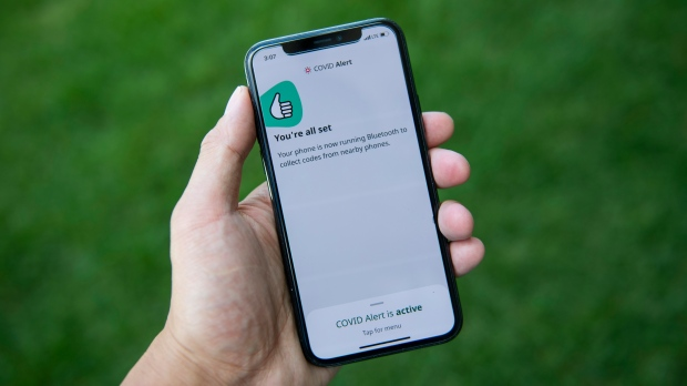 The COVID Alert app is seen on an iPhone in Ottawa, on Friday, July 31, 2020. The app tracks the locations of phones relative to other phones, and notifies users if they have been in proximity to another app user who has tested positive for COVID-19. (THE CANADIAN PRESS/Justin Tang)