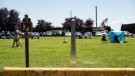 A Canada-U.S. border marker is seen in Surrey, B.C., as people gather at Peace Arch Historical State Park in Blaine, Wash., Sunday, July 5, 2020. THE CANADIAN PRESS/Darryl Dyck