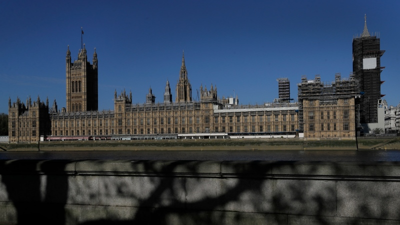 In this Tuesday, April 21, 2020 file photo, the sun shines above Britain's Houses of Parliament as the country is in lockdown to help curb the spread of coronavirus, in London. The conviction of a British lawmaker for sexual assault, and the arrest of another on rape allegations, are increasing pressure on Britain's political leaders to confront a political culture that has often let abuse go unchecked. (AP Photo/Kirsty Wigglesworth, File)