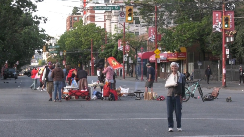 George Rubin stands in front of a group of protesters blocking traffic at Main and Hastings streets.
