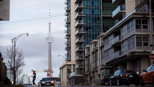 The CN Tower can be seen behind condos in Toronto's Liberty Village community in Toronto, Ontario on Tuesday, April 25, 2017. THE CANADIAN PRESS/Cole Burston