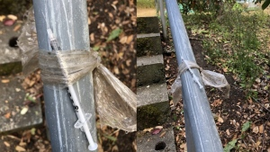 A used, uncapped needle was found strapped to a hand railing in Beacon Hill Park. (Victoria police handout)
