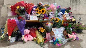 Memorial for Ingersoll woman who died on July 31, 2020 after she was struck by a transport truck while pushing a baby stroller. (Carmen Wong / CTV Kitchener)