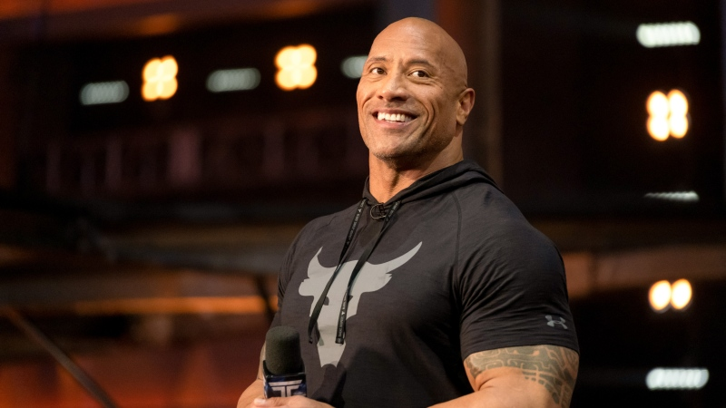 Dwayne 'The Rock' Johnson is teaming up with his ex-wife and a top sports management company to buy the bankrupt XFL football league for US$15 million. (Steve Dietl/NBC/NBCU Photo Bank/Getty Images/CNN)