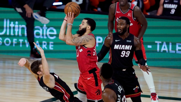 Toronto Raptors' Fred VanVleet (23) shoots as Miami Heat's Goran Dragic tries to draw the offensive foul during the second half of an NBA basketball game Monday, Aug. 3, 2020, in Lake Buena Vista, Fla. The Raptors won 107-103. (AP Photo/Ashley Landis, Pool)