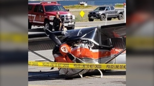 A damaged plane is seen in a parking lot in Nelson, B.C., on Monday, Aug. 3, 2020. (Photo from Jamie Moreau)