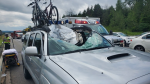 The windshield and roof of this pick-up truck was destroyed after a wheel separated from another car travelling southbound on Highway 400 on Monday, August 3, 2020 (Courtesy OPP)