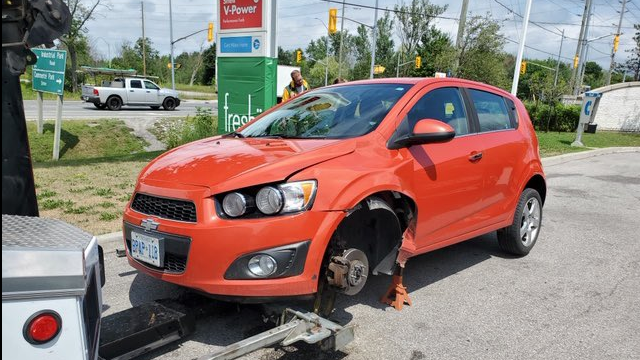 Police say a wheel separated from this car heading southbound on Highway 400, bounced into the northbound lane and collided with a pick-up truck on Monday, August 3, 2020 (Courtesy OPP)
