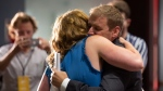 Dr. Andrew Furey is congratulated by his wife, Dr. Allison Furey as he is announced as leader of the provincial Liberal Party at the St. John's Convention Centre in St. John's, N.L. on Monday, August 3, 2020. THE CANADIAN PRESS/Paul Daly