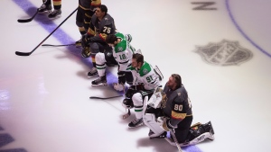 Dallas Stars' Jason Dickinson (18), Tyler Seguin (91) and Vegas Golden Knights' Ryan Reaves (75) and goalie Robin Lehner (90) take a knee for Black Lives Matter during the national anthem at the NHL qualifying round game action in Edmonton, on Monday August 3, 2020. THE CANADIAN PRESS/Jason Franson